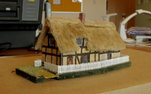 Alan's thatched cottage was built from a photo in a calendar with estimated measurements and was built to help improve his modelling of thatched items. It's already looking very good though he is continuing to make improvements.