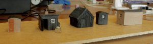 David's platelayers' huts, one in etched brass from a Severn Models kit and the remainder scratchbuilt from styrene and (very thin) Ambis corrugated roofing. The grinding wheel for sharpening scythe blades is scratchbuilt from wood, plastic sprue and brass wire.